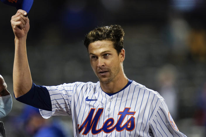 New York Mets starting pitcher Jacob deGrom tips his cap to fans after a baseball game against the Washington Nationals Friday, April 23, 2021, in New York. The Mets won 6-0. (AP Photo/Frank Franklin II)