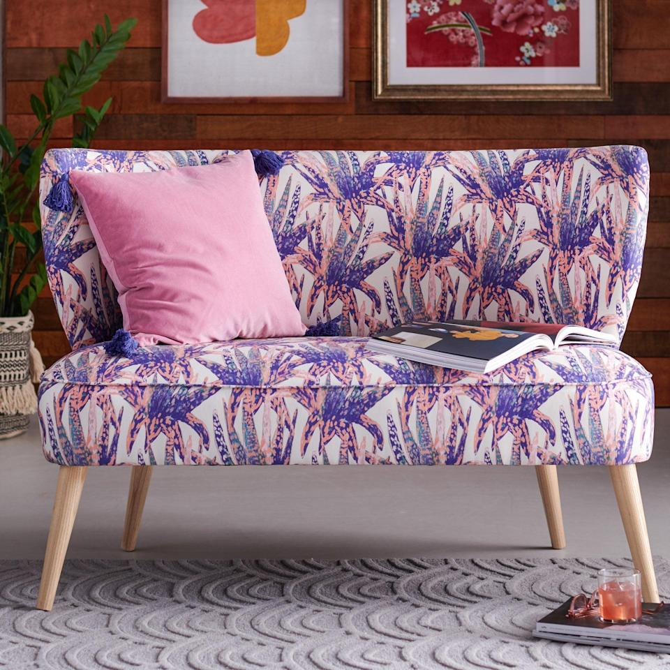 <p>This little <span>Drew Barrymore Flower Home Watercolor Succulent Loveseat</span> ($918) is the perfect little seat if you don't have room for a full-on sofa.</p>