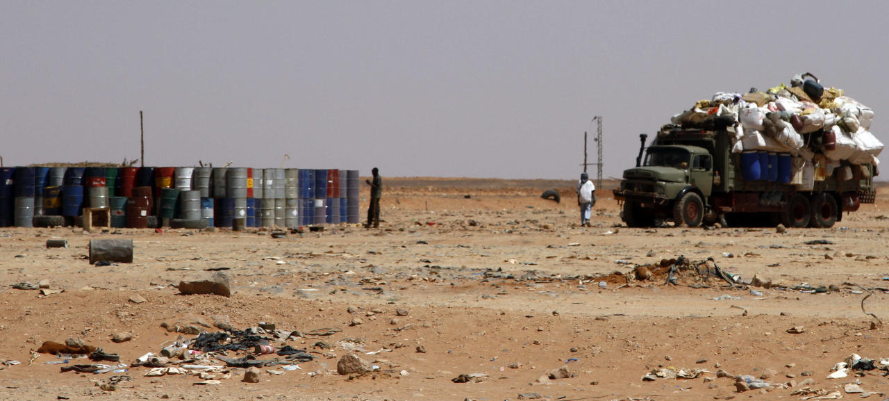 Huge trucks like this one outside Sebha in southern Libya on Sept. 22, 2013, are used to haul people and good, and sometimes smuggle weapons, to Niger to the south. In the rocky mountains and dune-covered wastes of southwestern Libya, al-Qaida's North African branch has established a haven and is now restocking weapons and mining disaffected minorities for new recruits as it prepares to relaunch attacks. (AP Photo/Paul Schemm).