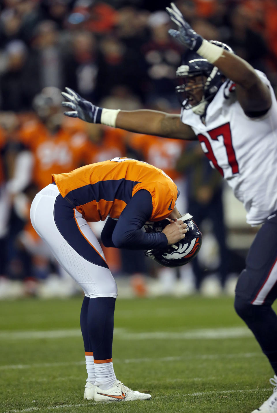 Denver Broncos kicker Brandon McManus hangs his head after missing a game winning field goal attempt as Houston Texans defensive end Angelo Blackson (97) celebrates during the second half of an NFL football game, Sunday, Nov. 4, 2018, in Denver. The Texans won 19-17. (AP Photo/David Zalubowski)