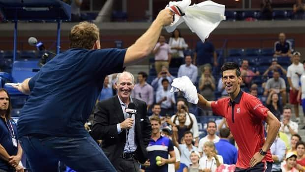 """""""Superfan"""" Cameron Hughes dances with Novak Djokovic, who had just defeated an opponent in a second-round match in New York at the 2015 U.S. Open."""
