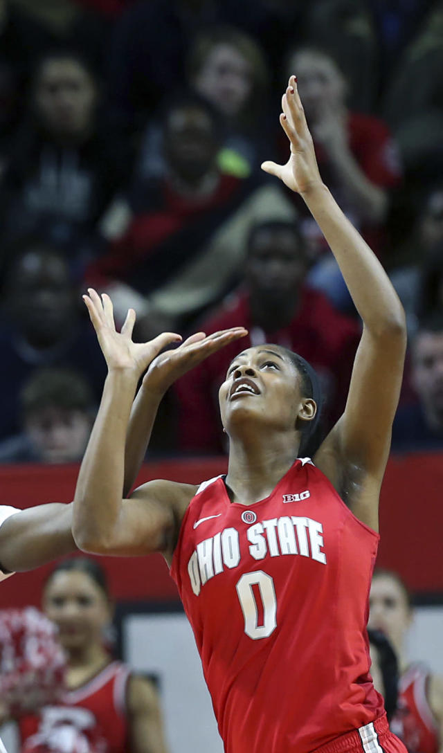 FILE - In this Feb. 26, 2017, file photo, then-Ohio State forward Tori McCoy battles for the ball against Rutgers during the first half of an NCAA college basketball game, in Piscataway, N.J. Tori McCoy hates having to watch Marquette practice from the sideline. For now, the Ohio State transfer must concentrate on her health. The junior forward needs a kidney transplant after being diagnosed with a rare disease. (AP Photo/Mel Evans, File)