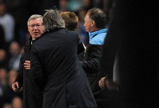 Alex Ferguson (left) and Roberto Mancini had to be separated during an explosive confrontation in the 76th minute