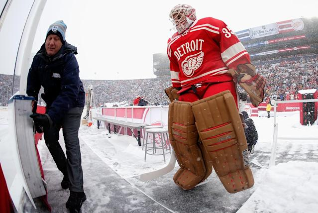 ANN ARBOR, MI - JANUARY 01: Goalie Jimmy Howard #35 of the Detroit Red Wings heads out onto the ice prior to the start of the 2014 Bridgestone NHL Winter Classic at Michigan Stadium on January 1, 2014 in Ann Arbor, Michigan. (Photo by Gregory Shamus/Getty Images)