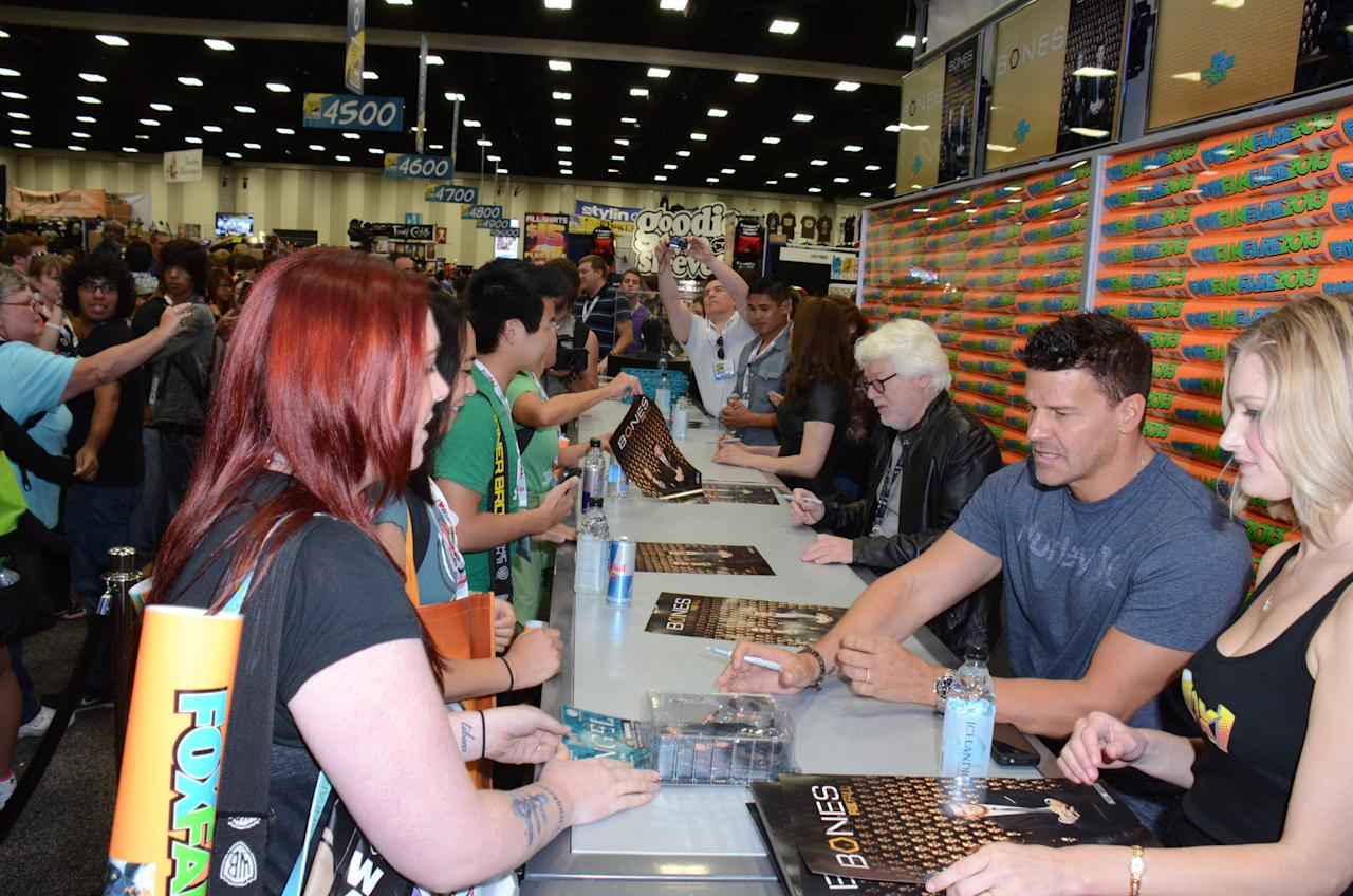 """Bones"" cast members and Executive Producers greet and sign an exclusive limited edition ""Bones"" poster for fans on Friday, July 19 during Fox Fanfare at San Diego Comic-Con 2013."