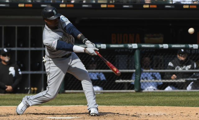 Seattle Mariners' Tim Beckham (1) hits a three-run home run against the Chicago White Sox during the fifth inning of a baseball game in Chicago, Saturday, April 6, 2019. (AP Photo/Matt Marton)
