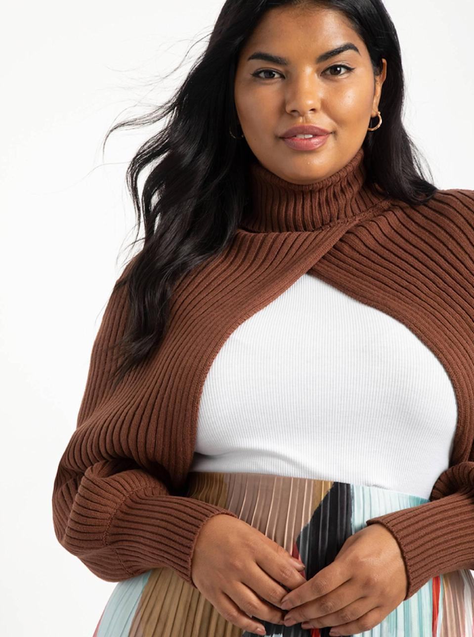 """She's smizing 'cause she knows she working this scarflike sweater. Take cues from the styling and pair it with a bodysuit and midi skirt—or swap the bottom half for leather trousers. Either would look *chef's kiss*. $70, Eloquii. <a href=""""https://www.eloquii.com/turtleneck-sweater-sleeve-scarf/1083039.html"""" rel=""""nofollow noopener"""" target=""""_blank"""" data-ylk=""""slk:Get it now!"""" class=""""link rapid-noclick-resp"""">Get it now!</a>"""