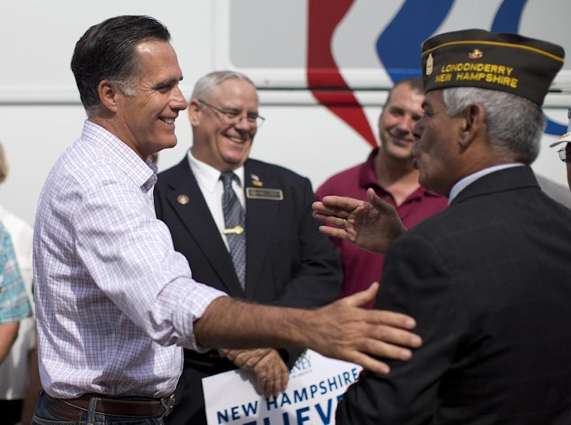 "Republican presidential candidate, former Massachusetts Gov. Mitt Romney speaks with military veterans outside an event by the ""New Hampshire Veterans and Military Families for Mitt"" in Concord, N.H., Thursday, Sept. 6, 2012. (AP Photo/Evan Vucci)"