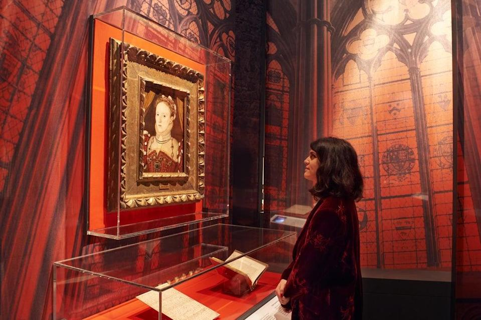 A visitor in front of a portrait of Elizabeth I attributed to George Gower, c.1567 (handout)