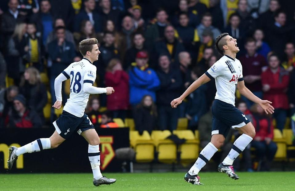 Tottenham Hotspur's midfielder Erik Lamela (R) celebrates with Tom Carroll (L) after scoring the opening goal of the match between Watford and Tottenham Hotspur on December 28, 2015 (AFP Photo/Olly Greenwood)