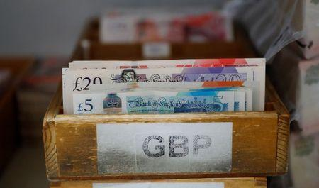 British Pound Sterling banknotes are pictured at the Money Service Austria company's headquarters in Vienna