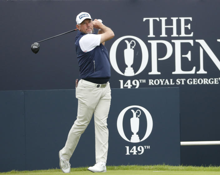 England's Lee Westwood plays his tee shot from the 1st tee during a practice round for the British Open Golf Championship at Royal St George's golf course Sandwich, England, Wednesday, July 14, 2021. The Open starts Thursday, July, 15. (AP Photo/Peter Morrison)