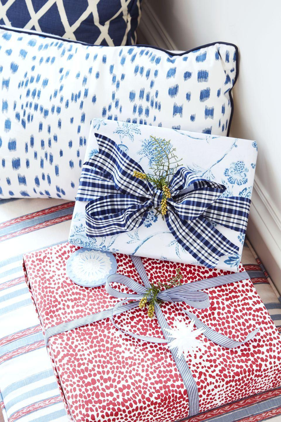 <p>What's under your tree counts just as much as what's on it. For a classic American theme, choose red, white, and blue paper and bows.</p>