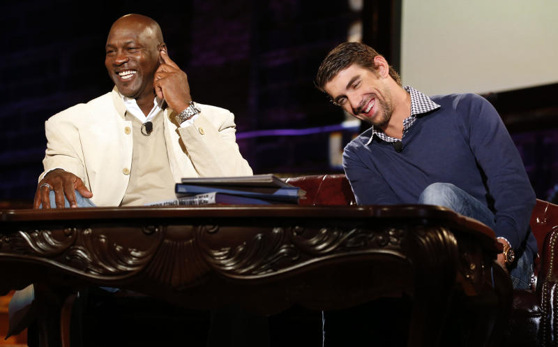 IMAGE DISTRIBUTED FOR GOLF CHANNEL - Michael Jordan, left, and Michael Phelps as seen at Golf Channel's 'Feherty Live From the Ryder Cup', on Monday, September 24, 2012 at the Tivoli Theatre in Downers Grove, IL. (Ross Dettman/AP Images for Golf Channel)