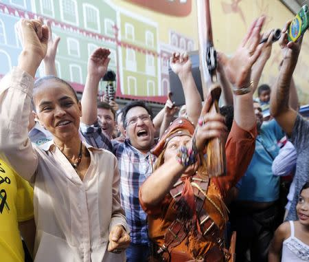 Brazil's Socialist Party presidential candidate Marina Silva (L) attends a campaign rally in Sao Paulo August 24, 2014. REUTERS/Paulo Whitaker