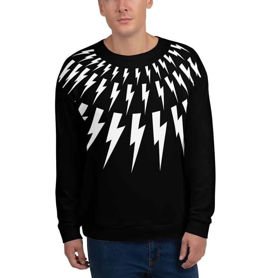 """<p><strong>M Designs Crafts</strong></p><p>mdesignscrafts.com</p><p><strong>$54.00</strong></p><p><a href=""""https://www.mdesignscrafts.com/products/the-david-rose-unisex-sweatshirt"""" rel=""""nofollow noopener"""" target=""""_blank"""" data-ylk=""""slk:Shop Now"""" class=""""link rapid-noclick-resp"""">Shop Now</a></p><p>Let's be real, <em>all</em> of David's signature black and white lewks are iconic... but the lighting bolt has gotta be at the top of the list. It's also versatile as hell, and therefore a perfect gift for anyone and everyone. </p>"""