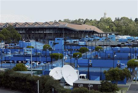 Empty tennis courts are seen as play is suspended due to the extreme heat policy put into place at the Australian Open 2014 tennis tournament in Melbourne January 16, 2014. REUTERS/Jason Reed
