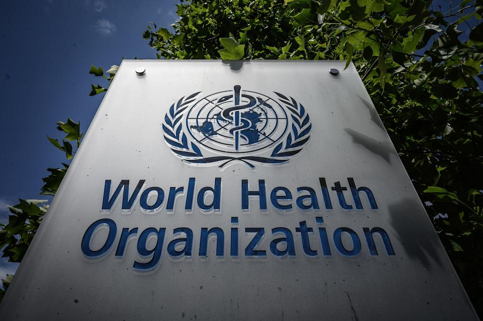This photograph taken on July 3, 2020, shows a sign of the World Health Organization (WHO) at their headquarters in Geneva, amidst the COVID-19 outbreak, caused by the novel coronavirus. (Photo by Fabrice COFFRINI / AFP) (Photo by FABRICE COFFRINI/AFP via Getty Images)