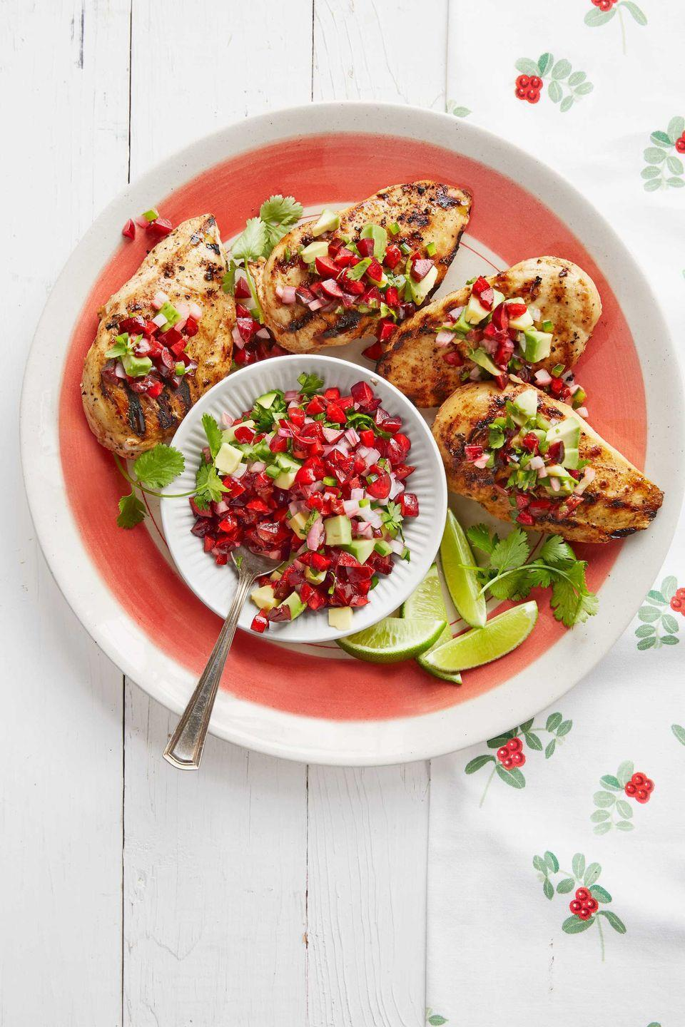"""<p>Grilled chicken gets a lift with this flavor-packed marinade and fresh, fruity salsa.</p><p><strong><a href=""""https://www.countryliving.com/food-drinks/recipes/a38958/chili-garlic-grilled-chicken-with-avocado-cherry-salsa-recipe/"""" rel=""""nofollow noopener"""" target=""""_blank"""" data-ylk=""""slk:Get the recipe"""" class=""""link rapid-noclick-resp"""">Get the recipe</a>.</strong></p>"""