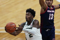 Michigan State guard Rocket Watts makes a layup as Detroit Mercy guard Matt Johnson (13) defends during the second half of an NCAA college basketball game, Friday, Dec. 4, 2020, in East Lansing, Mich. (AP Photo/Carlos Osorio)