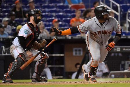 Jun 14, 2018; Miami, FL, USA; San Francisco Giants third baseman Pablo Sandoval (48) hits a two run single in the 16th inning at Marlins Park. Mandatory Credit: Jasen Vinlove-USA TODAY Sports