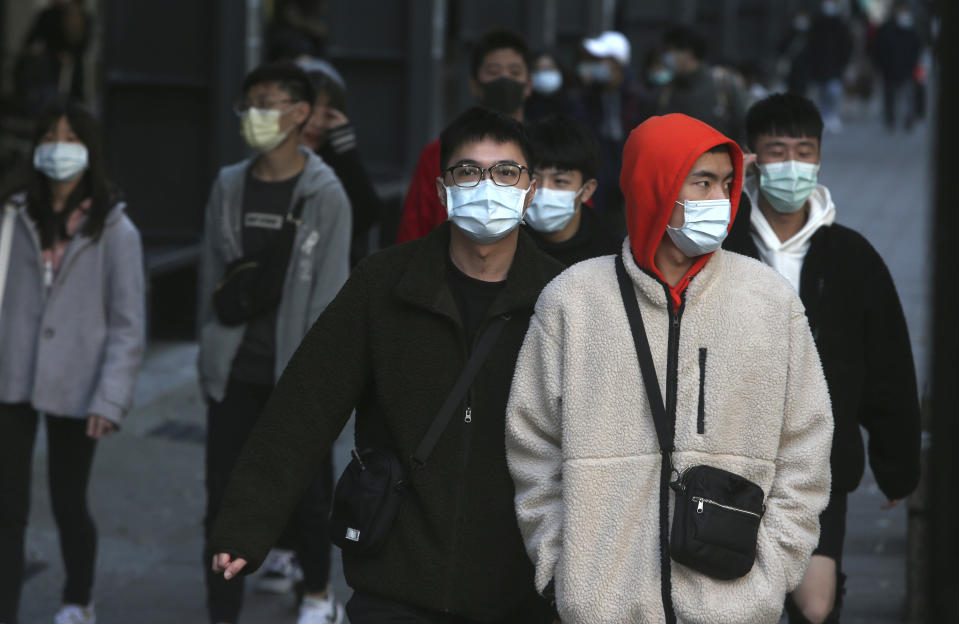 People wear face masks and walk at a shopping mall in Taipei, Taiwan, Friday, Jan. 31, 2020. People wear face masks as they walk through a shopping mall in Taipei, Taiwan, Friday, Jan. 31, 2020. According to the Taiwan Centers of Disease Control (CDC) Friday, the tenth case diagnosed with the new coronavirus has been confirmed in Taiwan. (AP Photo/Chiang Ying-ying)