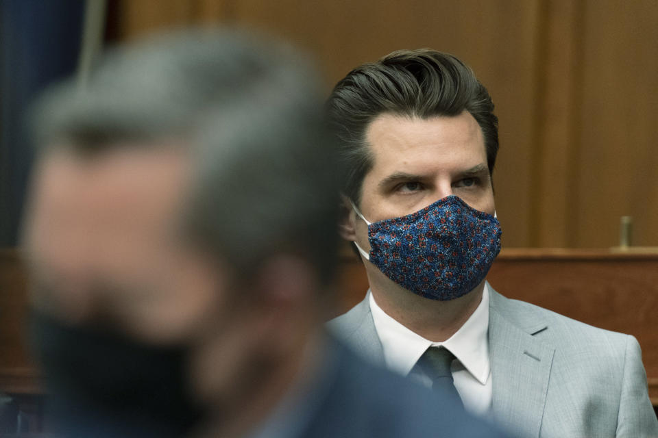 Rep. Matt Gaetz, R-Fla., looks at the video monitor during a House Armed Services Committee hearing on Capitol Hill, Wednesday, April 14, 2021, in Washington. (AP Photo/Manuel Balce Ceneta)