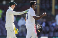 Australian captain Tim Paine, left, congratulates not out batsman India's Ravichandran Ashwin following play on the final day of the third cricket test between India and Australia at the Sydney Cricket Ground, Sydney, Australia, Monday, Jan. 11, 2021. The test ended in a draw and the series is at 1-1 all with one test to play. (AP Photo/Rick Rycroft)