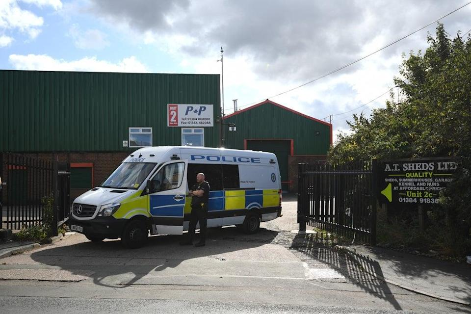 Police at Albion Works industrial estate in Brierley Hill, West Midlands, after the double shooting (Joe Giddens/PA) (PA Wire)