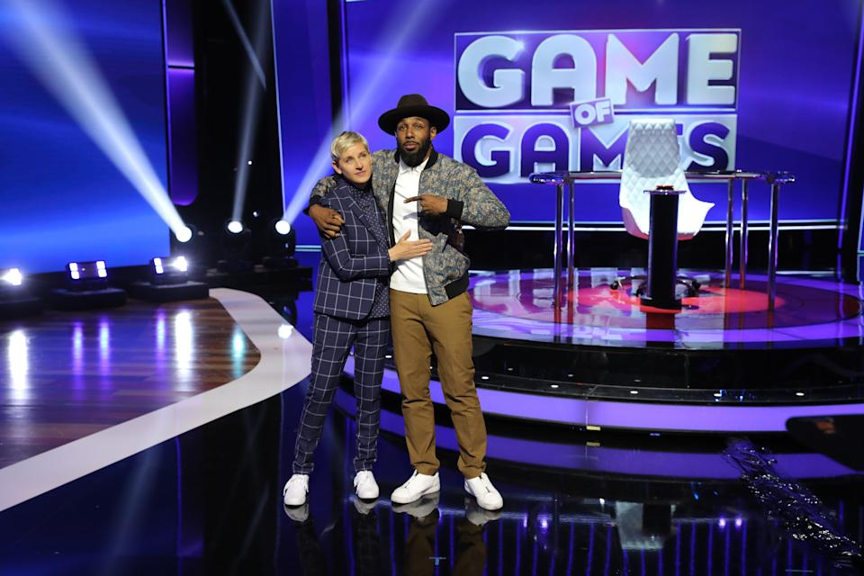 """ELLEN'S GAME OF GAMES -- """"The Sound of Musical Chairs"""" Episode 201 -- Pictured: (l-r) Ellen DeGeneres, Stephen Laurel """"tWitch"""" Boss -- (Photo by: Mike Rozman/NBCU Photo Bank/NBCUniversal via Getty Images via Getty Images)"""