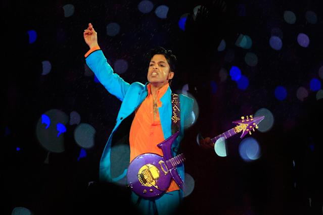 Prince performs in the rain during the 'Pepsi Halftime Show' at Super Bowl XLI between the Indianapolis Colts and the Chicago Bears on February 4, 2007 at Dolphin Stadium in Miami Gardens, Florida. (Photo by Jamie Squire/Getty Images)