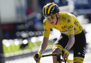 Slovenia's Tadej Pogacar, wearing the overall leader's yellow jersey, strains during the twenty-first and last stage of the Tour de France cycling race over 108.4 kilometers (67.4 miles) with start in Chatou and finish on the Champs Elysees in Paris, France,Sunday, July 18, 2021. (AP Photo/Christophe Ena)