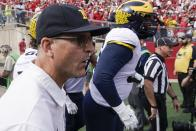 Michigan head coach Jim Harbaugh leads his team on the field before an NCAA college football game against Wisconsin Saturday, Oct. 2, 2021, in Madison, Wis. (AP Photo/Morry Gash)