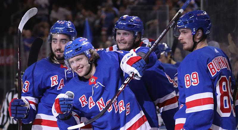 Artemi Panarin celebrates his first goal with the New York Rangers alongside Mika Zibanejad, Jacob Trouba and Pavel Buchnevich during the second period against the Winnipeg Jets at Madison Square Garden on October 03, 2019 in New York City. (Photo by Bruce Bennett/Getty Images)