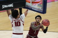 Colgate's Jordan Burns (1) puts up a shot against Arkansas's Jaylin Williams (10) during the first half of a first round game at Bankers Life Fieldhouse in the NCAA men's college basketball tournament, Friday, March 19, 2021, in Indianapolis. (AP Photo/Darron Cummings)