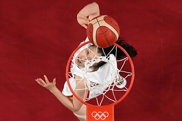 <p>China's Shao Ting goes to the basket in the women's quarter-final basketball match between China and Serbia during the Tokyo 2020 Olympic Games at the Saitama Super Arena in Saitama on August 4, 2021. (Photo by Aris MESSINIS / POOL / AFP)</p>