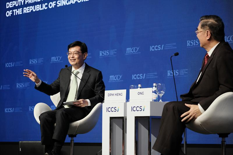 Deputy Prime Minister and Finance Minister Heng Swee Keat (left), in dialogue with Ambassador Ong Keng Yong at the International Conference on Cohesive Societies (ICCS) at Raffles City Convention Centre on Friday, 21 June 2019. PHOTO: ICCS