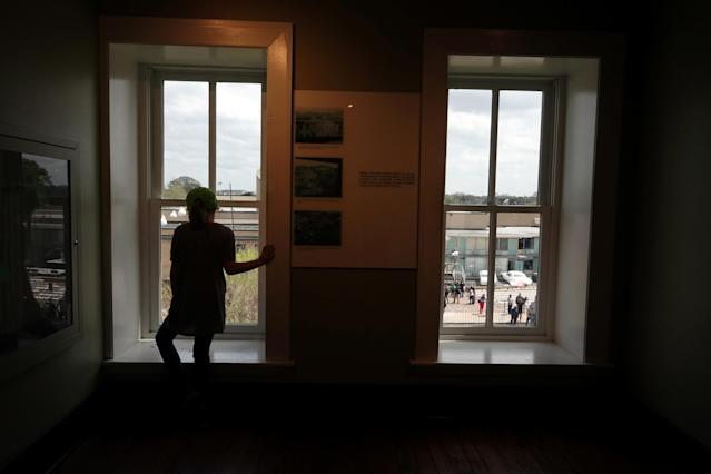 <p>Visitors look at the balcony where MLK was shot at the the Lorraine Motel, now the National Civil Rights Museum, from the view of the gunman, during events surrounding the 50th anniversary of the death of civil rights leader Martin Luther King Jr. in Memphis, Tenn., April 3, 2018. (Photo: Karen Pulfer Focht/Reuters) </p>
