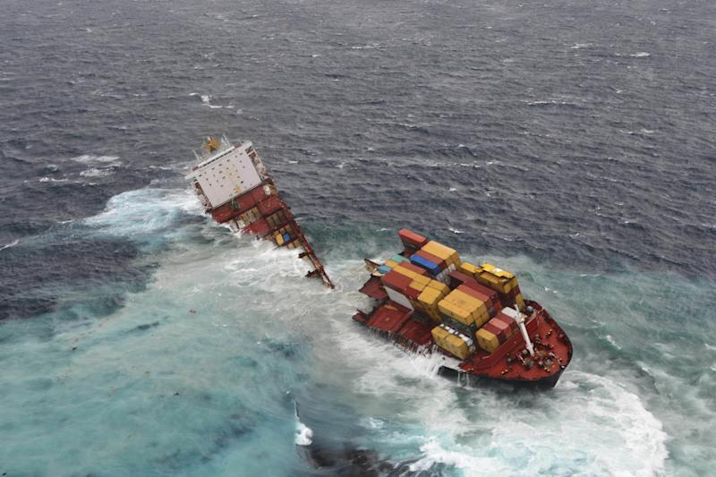 In this Sunday, Jan. 8, 2012 photo provided by Maritime New Zealand, the stranded cargo ship Rena breaks in two pieces after overnight storms with 19 foot, (six meter) waves pounding the vessel, off Tauranga Harbor, New Zealand. The Greek-owned Rena ran aground on Astrolabe Reef 14 miles (22 kilometers) from Tauranga Harbor on North Island on Oct. 5, 2011, spewing heavy fuel oil into the seas in what has been described as New Zealand's worst maritime environmental disaster. (AP Photo/Maritime New Zealand) EDITORIAL USE ONLY