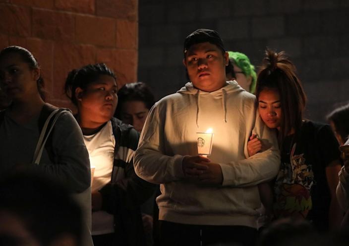 <p>Mourners stand in silence during a candlelight vigil at the University of Nevada Las Vegas (UNLV) for victims of a mass shooting in Las Vegas, Nevada, USA, 02 October 2017. (Photo: Eugene Garcia/EPA-EFE/REX/Shutterstock) </p>