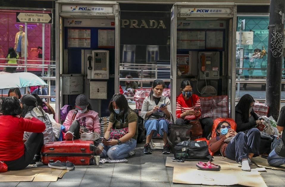 Domestic helpers are a regular weekend sight on the city's streets but a poll has found some are being deprived of their day off. Photo: Nora Tam