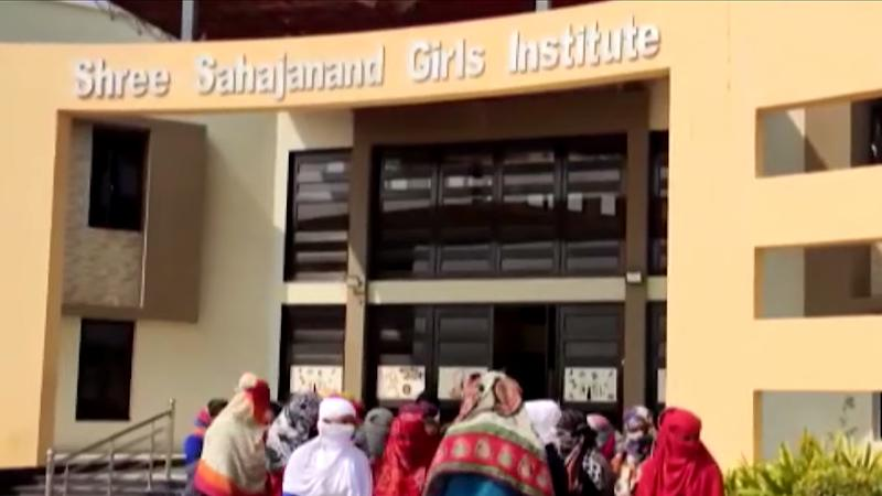 Picture of female students outside the Shree Sahajanand Girls Institute in India, where women were asked to strip to their underwear to determine whether they were on their periods or not