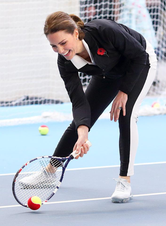 The Wimbledon regular was all smiles during a visit to the Lawn Tennis Association at the National Tennis Centre in Oct. 2017. She rocked grey sneakers for the occasion, paired with black and white athletic pants, a polo shirt and a pullover sweater.