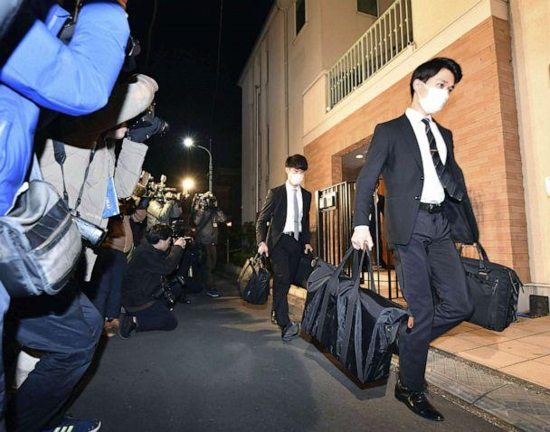 PHOTO: Officials from the Tokyo District Public Prosecutors Office carry bags after raiding the Tokyo residence of former Nissan chairman Carlos Ghosn in Tokyo, Jan. 2, 2020. (Kyodo via Reuters)
