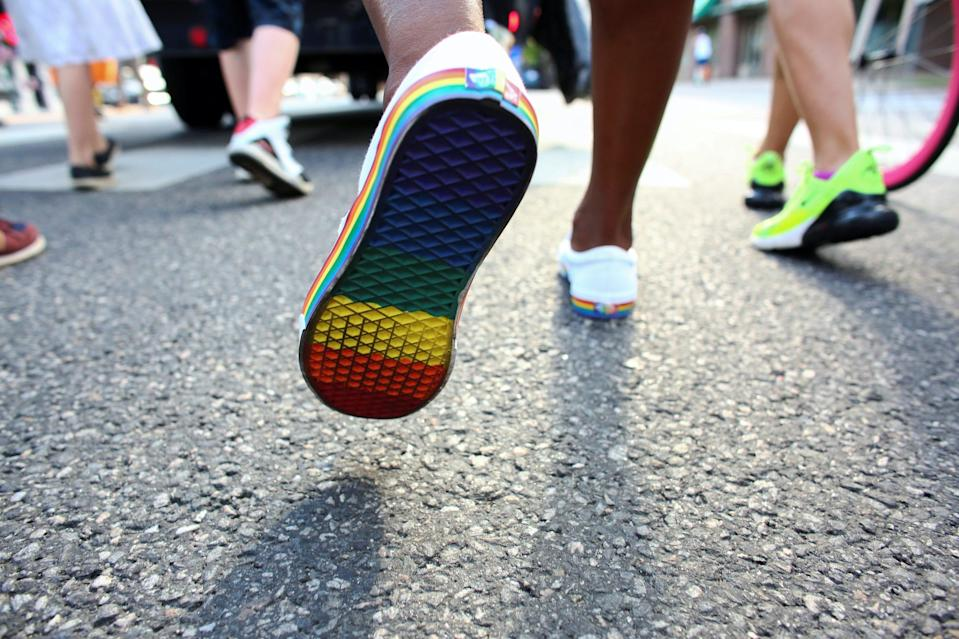 A demonstrator, wearing shoes with rainbow colored soles, walks during the Pride Liberation March, an event highlighting the Black Lives Matter movement within the LGBTQ community in Denver, Colorado, U.S., June 14, 2020.