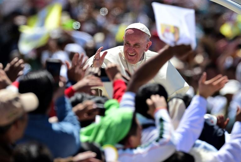 Pope Francis waves from the popemobile in San Cristobal de Las Casas on February 15, 2016