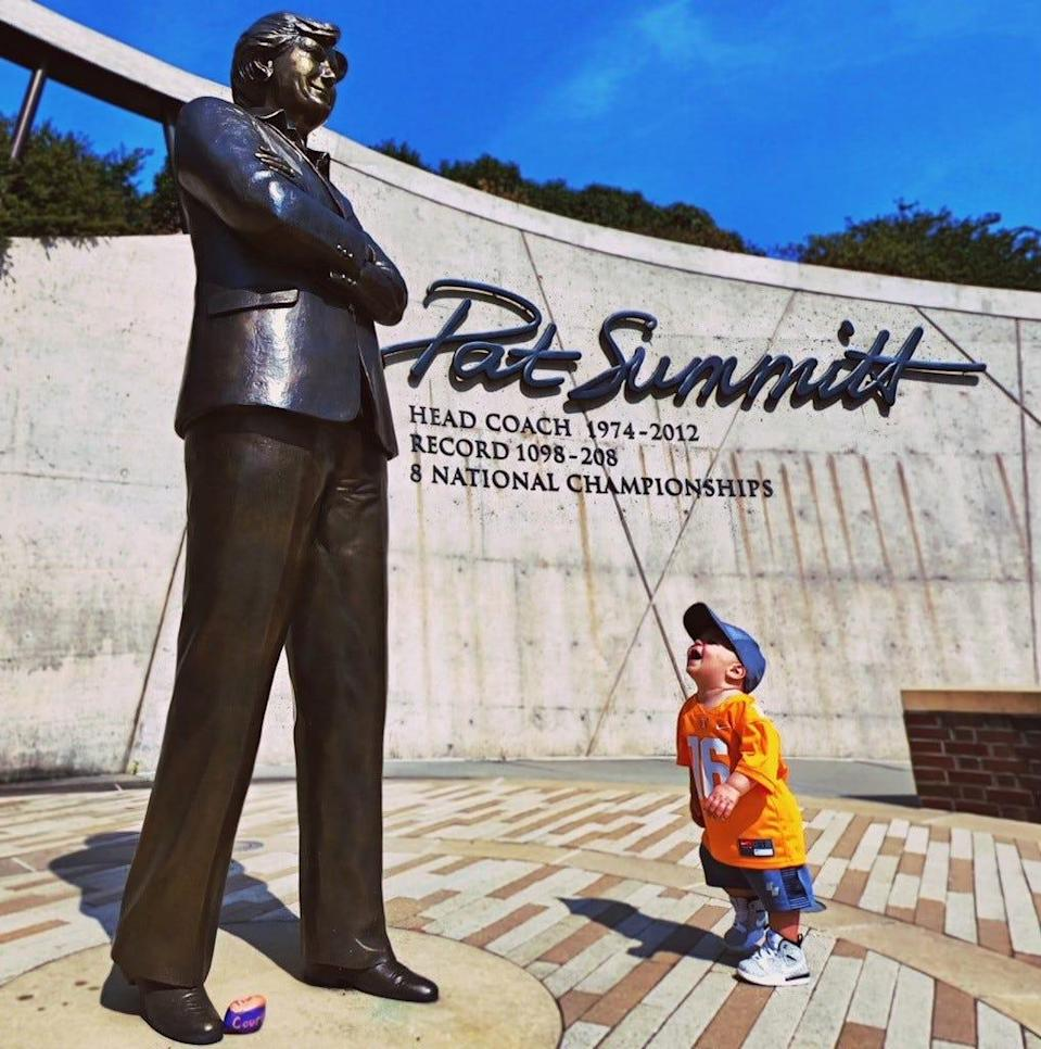 Breck Summitt stands at the base of a statue of his grandmother, legendary coach Pat Summitt.