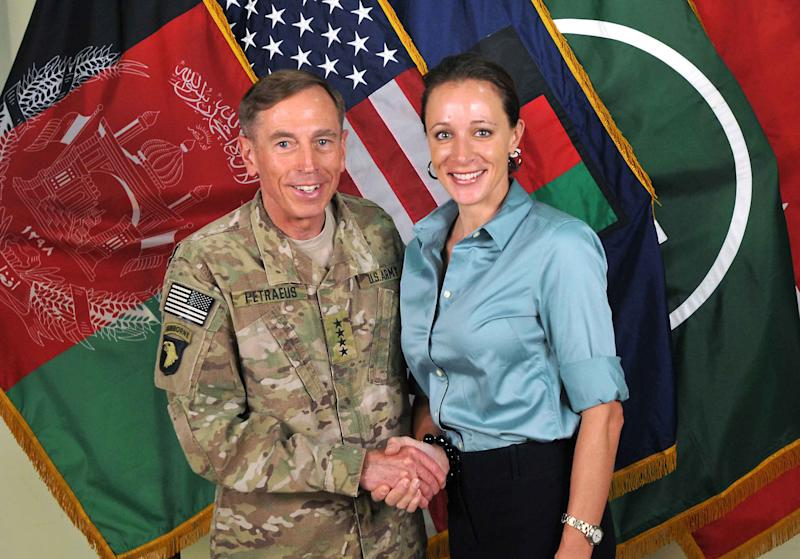 """FILE - This July 13, 2011, photo made available on the International Security Assistance Force's Flickr website shows the former Commander of International Security Assistance Force and U.S. Forces-Afghanistan Gen. Davis Petraeus, left, shaking hands with Paula Broadwell, co-author of his biography """"All In: The Education of General David Petraeus."""" The affair between retired Army Gen. David Patraeus and author Paula Broadwell is but an extreme example of the love/hate history between biographers and their subjects. (AP Photo/ISAF, file)"""