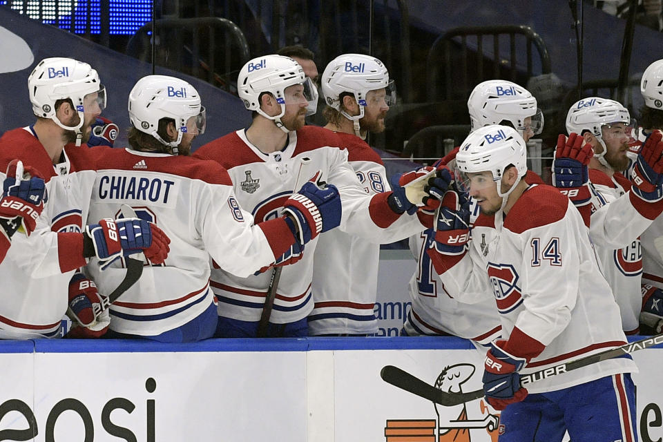 Montreal Canadiens center Nick Suzuki (14) skates by the bench after scoring a power play goal during the second period in Game 2 of the NHL hockey Stanley Cup finals against the Tampa Bay Lightning, Wednesday, June 30, 2021, in Tampa, Fla. (AP Photo/Phelan Ebenhack)