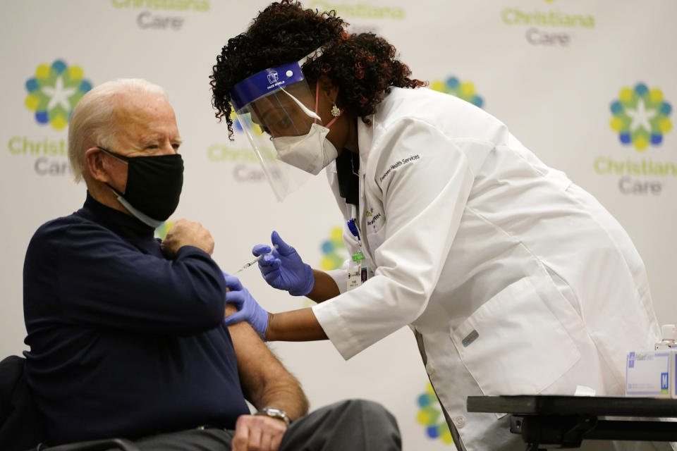 President-elect Joe Biden receives his first dose of the coronavirus vaccine at ChristianaCare Christiana Hospital in Newark, Del., Monday, Dec. 21, 2020, from nurse practitioner Tabe Mase. (AP Photo/Carolyn Kaster)